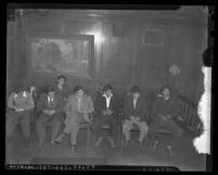 Seven Latino men, arrested in zoot suit clash, seated in Los Angeles, Calif. courtroom in 1943