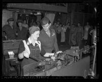 Aircraft worker Flora May Foss and her brother, Marine Joe Foss at Vega Aircraft Corp in Burbank, Calif.