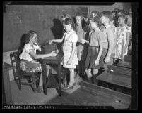 Class of school children donating money to Los Angeles War Chest, circa 1943
