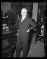 Charlie Chaplin standing in Los Angeles courtroom during 1945 paternity trial