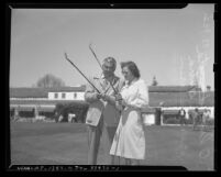 Olin Dutra and Babe Didrikson Zaharias golfing, circa 1945