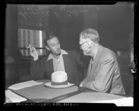 Los Angeles chiropractor, Samuel D. Collins arrested on suspicion of murder with his attorney Percy Hammon in 1945