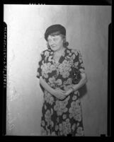 Aline Barnsdall, 3/4 length portrait, taken during 1945 court case over dog lease law in Los Angeles, Calif.