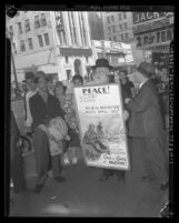 "Rabbi Moses J. Bergman carrying poster reading ""Open the Gate of Palestine"" outside the consulate, Los Angeles, 1945"