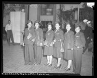 Six Filipino American nurses arriving in after release from Japanese prison, Los Angeles, 1945