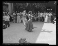 Crowd watching two dancers at the 1945 Los Angeles Filipino Fiesta