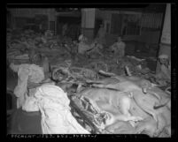 Male workers in delivery area of a meat packing plant in Los Angeles, Calif., circa 1945