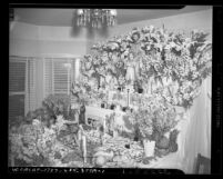 St. Joseph shrine laden with flowers, bread, pastries and fruit, circa 1946