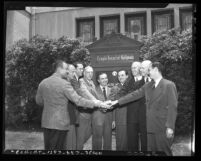 Nine men posing in front of Temple Israel of Hollywood in 1946
