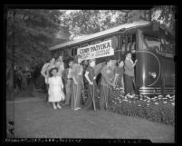 Teenagers boarding bus to Camp Paivika, Easter Seals Camp for Crippled Children in 1946