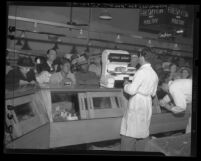 Customers at meat counter of Los Angeles' Grand Central Market in 1946