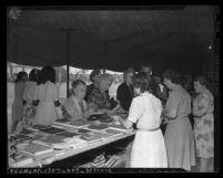 Women browsing book table at the 1946 Seventh Day Adventists camp meeting in Lynwood, Calif.