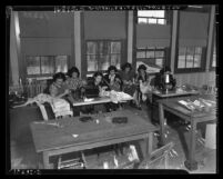 Group of young women sewing at National Youth Administration's Macy Street school, Los Angeles, circa 1938