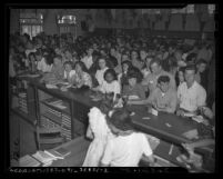 Students waiting at counter on first day of classes in 1946 at Los Angeles City College