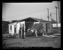 Workers constructing prefabricated house made by Hamill and Jones Lumber Company in Los Angeles, Calif., 1946