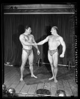 Bert Goodrich, Mr. America 1939 shaking hands with Mr. America 1946 Alan Stephan