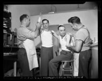 Two veterans being fitted for prosthetic limbs at UCLA's National Research Council Committee on Artificial Limbs