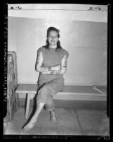 Inez Geraldine Wray, aka Sweet and Sour Mickey, displaying her tattooed arms, circa 1947