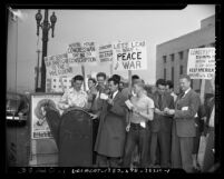 "Men mailing their draft cards to the U.S. president during ""conchie"" demonstration outside Los Angeles Federal Building, 1947"