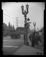 John C. Fremont High School students hanging effigy from lamp post in protest over enrollment of black students in Los Angeles, Calif., 1947