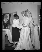 Hollywood fashion designer Edith Head working on a wedding gown for Dick Tracy comic strip's Gravel Gertie, 1946