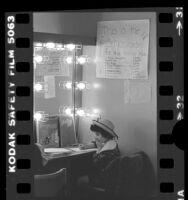"""Annie"" cast member Michele De Cuir in schoolroom backstage at Shubert Theatre, Calif., 1979"