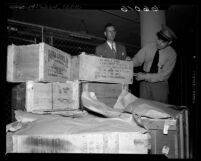 Los Angeles Customs Inspectors looking over boxes of scientific material belonging to California Institute of Technology professor Dr. Hsue-shen Tsien, 1950