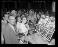 Crowd receiving free tickets for Hollywood Bowl's California Centennial pageant, Los Angeles, 1950