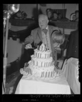 Mayor Fletcher Bowron cutting a birthday cake marking the Centennial anniversary for the city of Los Angeles, Calif., 1950