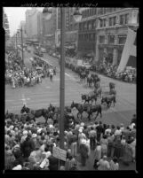 Crowd watching twenty-mule-team wagon from Death Valley parading down Broadway during Centennial event for Los Angeles, Calif., 1950