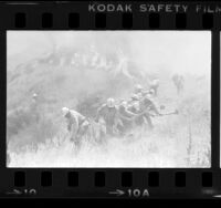 Fire camp crew creating break in wildfire near Newhall, Calif., 1979