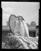 Florine Gonsalves crowns Our Lady of Fatima statue during Portuguese festival in Artesia, Calif., 1948