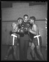 Reverend Samuel Odell Jones, formerly Sammy Odell, coaches boxers Benny Jones and Bobby Delgardo in Los Angeles, Calif., 1948