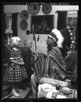 Chief Marcus Golsh entertains children in his adobe home in San Diego, Calif., 1959