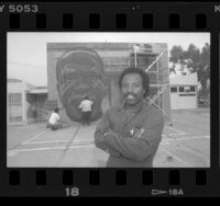 Richard Wyatt with his mural of Cecil Fergerson at the Watts Towers Arts Center, Calif., 1989