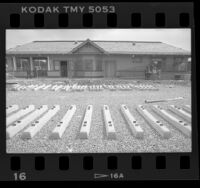 Rail ties laying out front of Watts Red Car Station, Calif., 1989