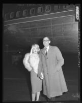 Marilyn Monroe accompanied by her husband, playwright Arthur Miller arrives at Los Angeles International Airport, 1959