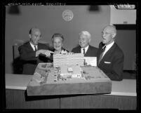 Clark Kerr, Lillian Dykstra, Donald H. McLaughlin, and Vern O. Knudsen viewing model of UCLA's Dykstra Dormitory, 1959