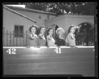 Police cadets Melva Myers, Betty Webster, Norma Johnston, Janet Elvedahl and Betty Hern posing with guns in Los Angeles, Calif., 1948