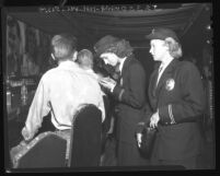 Policewomen Chloe Elwood and Janet Elvedahl checking IDs in a bar in Los Angeles, Calif., 1948