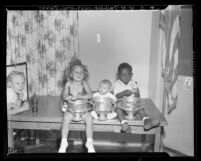 Three winners of a baby contest held by residents of housing projects in Los Angeles, Calif., 1948