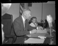 Florence Wasson answering questions from coroner Ira Nance at inquiry on Carol Landis' suicide, Calif., 1948