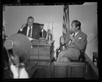 Actor Rex Harrison answering questions from coroner Ira Nance at inquiry on Carol Landis' suicide, Calif., 1948