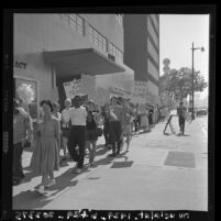 Students and sympathizers parading westward on Wilshire Blvd for world peace and disarmament; Los Angeles, Calif., 1960