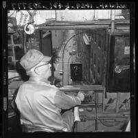 Joseph M. Cooper operates Angels Flight in Los Angeles, Calif., 1960