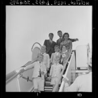 Senator John F. Kennedy with brother Robert, sister Eunice Shriver, leave by plane, Los Angeles, Calif., 1960