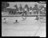 Jim Kelsey, a former UCLA Bruin star gets set to throw a goal in water polo, 1960