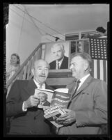 "Actor Adolph Menjou looks over a copy of  ""The Conscience of a Republican [Conservative],"" with Paul H. Talbert, 1960"
