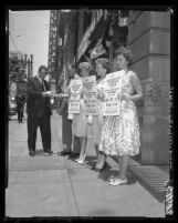 Four Jehovah's Witnesses members handing out literature in Los Angeles, Calif., 1960