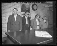 Jimmy Rist, Sol Davis, Mickey Cohen and Mike Howard being booked on suspicion of murder in Los Angeles, Calif., 1948